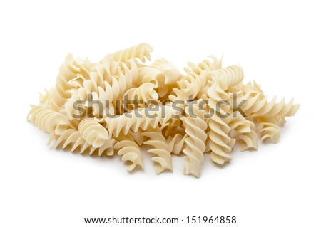 bunch of raw pasta fusilli on white background
