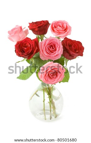 Bunch of red and pink roses in vase isolated on white