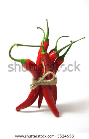 bunch of red hot chilli chilies pepper, tied by rope