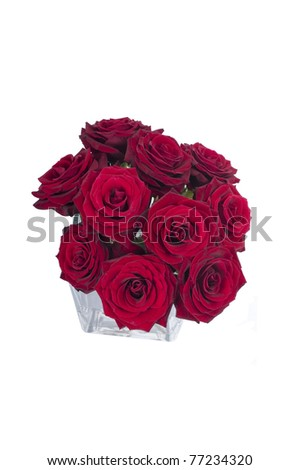 Bunch of red rose flowers in a small vase (top view)