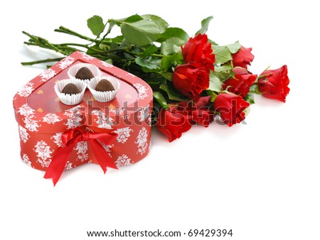 bunch of red roses and  heart-shaped gift with chocolate for St.Valentine's Day