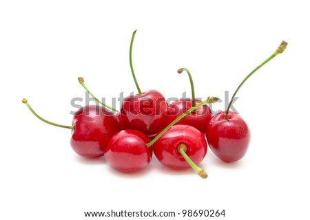 bunch of ripe and juicy cherries isolated on a white background close-up