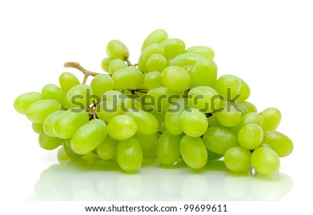bunch of ripe and juicy green grapes close-up on a white background