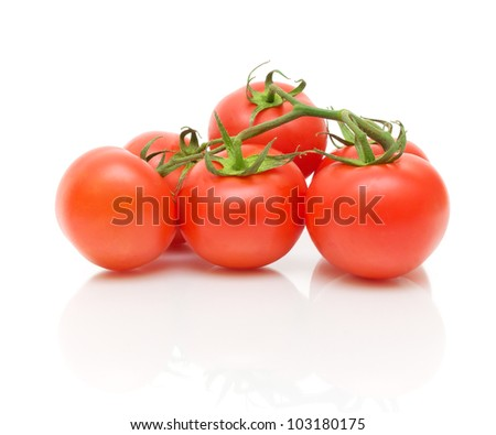bunch of ripe tomatoes isolated on white close-up