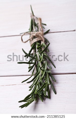 Bunch of rosemary on a rustic wood