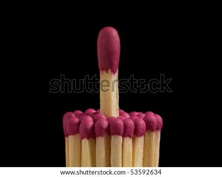 Bunch of small matches and big one isolated over black, leadership and individuality concept
