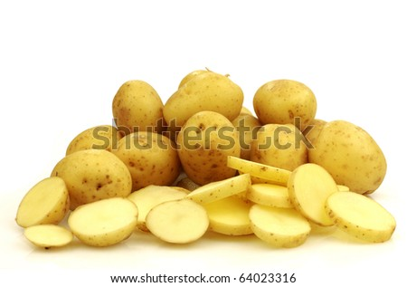 bunch of small potatoes and sliced ones on a white background