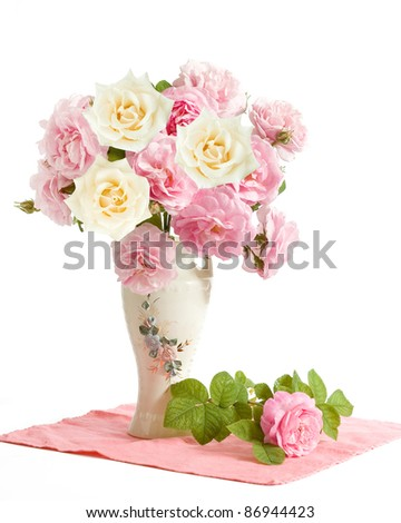 Bunch of tea and cream roses in the vase isolated on white
