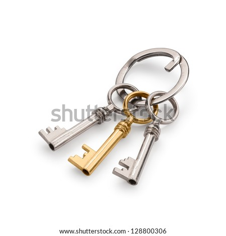 Bunch of three old keys, with a golden one. Isolated on white with clipping path and soft shadows.