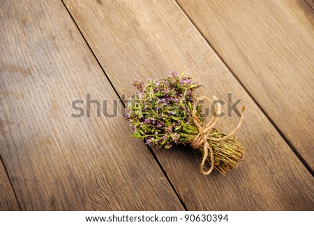 Bunch of thyme herb  on the oak table