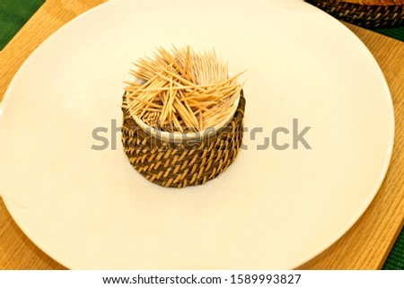 Bunch of tooth picks sticks in the plate