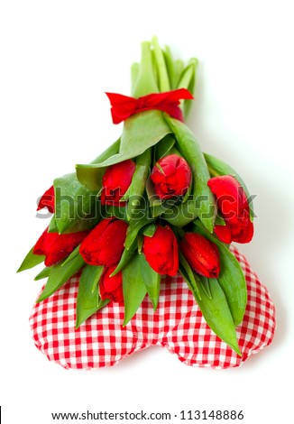 bunch of tulips on heart pillow - stock photo