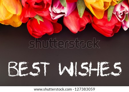 Bunch of tulips with blackboard: best wishes