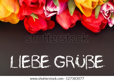 Bunch of tulips with blackboard: kind  regards