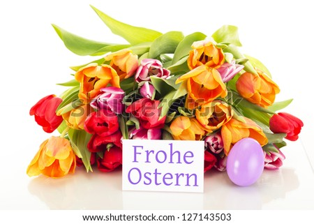 Bunch of tulips with easter egg and card: happy easter