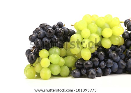Bunch of white and black grapes. Isolated on a white background.