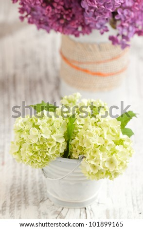 Bunch of white flowers on white wooden table
