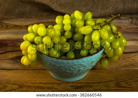 bunch of white grapes on a dark ...