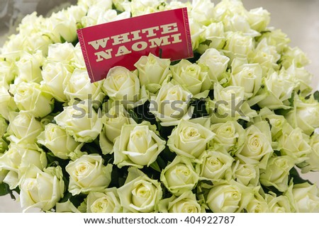 Bunch of white Naomi roses with name label #404922787