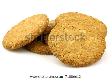 bunch of wholemeal cookies on a white background