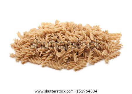 bunch of wholemeal flour fusilli pasta, on white background