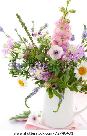 Bunch of wild herbs and flowers in a  jug