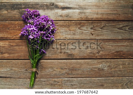 Bunch of willow-herb on wooden background