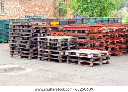 Bunch of wooden industrial euro palettes in factory storage