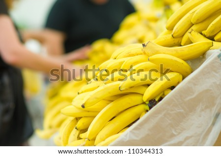 Bunch of yellow and green bananas in supermarket