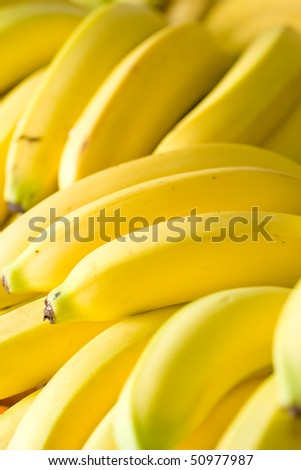 Bunches of ripe bananas in grocery shop