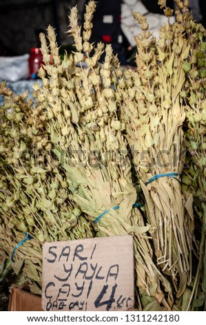 Bunches of wild dried herbs - translated the the sign says Sari Yayla Cayi - Yellow Highland Tea and Dag Cayi which is Mountain Tea