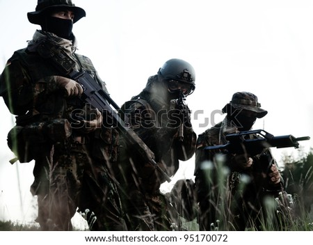 Bundeswehr soldiers in full gear - stock photo