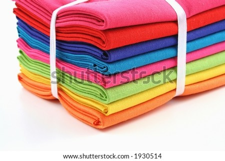 Bundle of coloured material on a white background