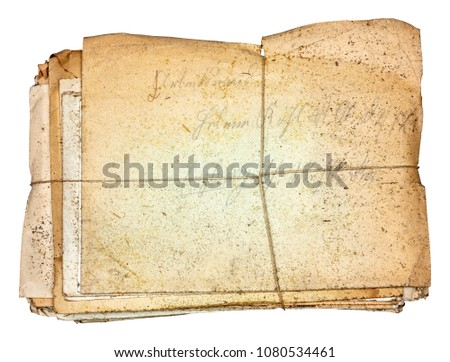 Bundle of dirty dusty old antique letters, tied with cord, isolated on white background