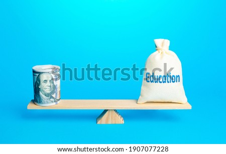 Bundle of dollars and a bag of Education on scales. Investments of budgetary funds in the educational system, a policy of improving quality of education and the release of highly qualified specialists Stock photo ©