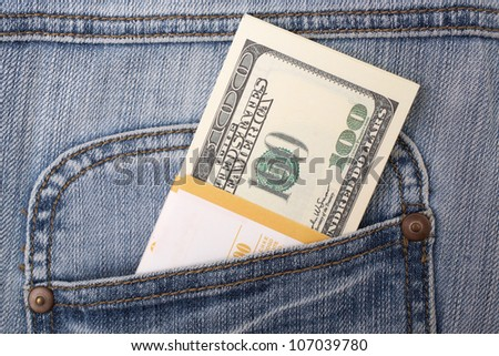 bundle of dollars in a jeans pocket, closeup