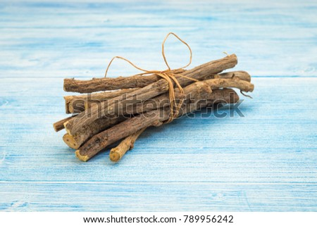 bundle of licorice roots Glycyrrhiza glabra on rustic table