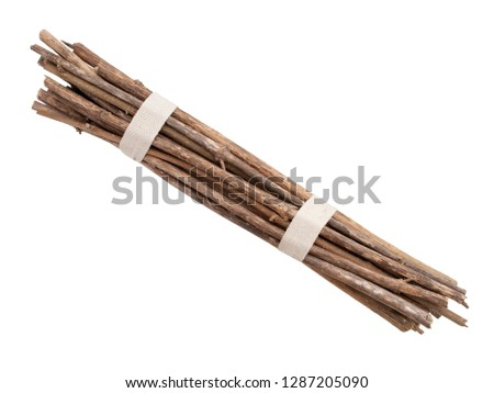Bundle of sticks, twigs, isolated over white. Two ties. #1287205090