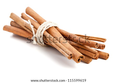 Bundled dried cinnamon sticks over white background