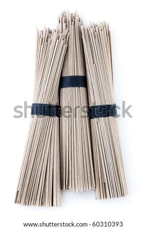 Bundles of raw buckwheat soba noodles. Isolated on white.