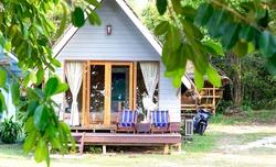 Bungalow house hidden in luxuriant vegetation in Thailand island