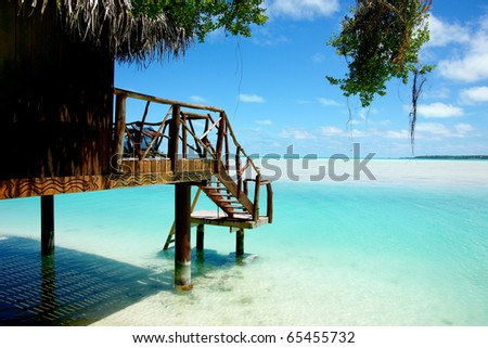 Bungalow on edge of tropical lagoon