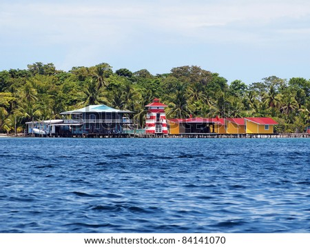 Bungalows, house and a lighthouse over the sea on a tropical Caribbean island, Bocas del toro, Panama