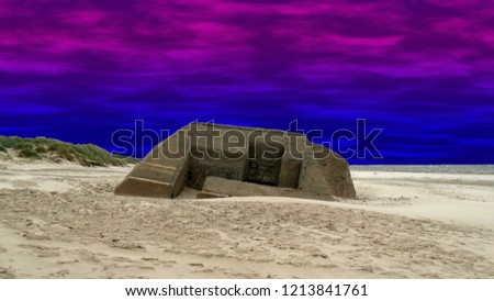 bunkers and concrete constructions on the beach in the Danish part of the Atlantic Wall. It was a coastal defense line along the west coast of Jutland in the second world war.  edited pic.  night.