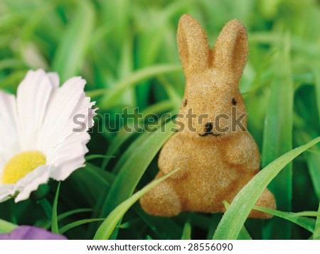 Bunny figurine with silk flower and artificial turf