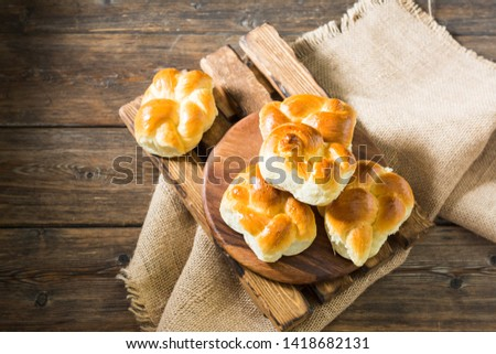 Buns on wooden background. Rustic pastries. Rustic style