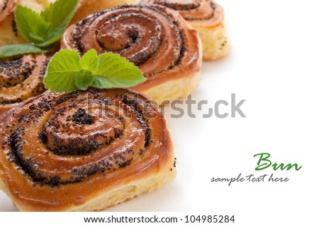 Buns with poppy seeds on a white background