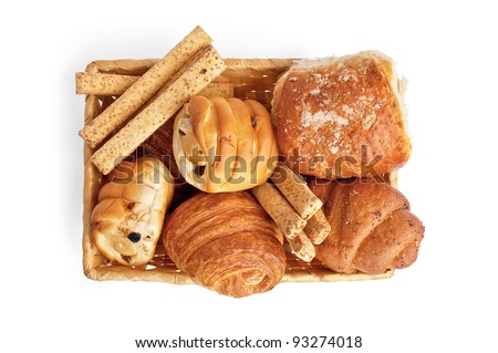 Buns with raisins, bread sticks, croissants, puff bun with grit in a wicker basket isolated on white background