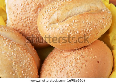 buns with sesame seeds on  yellow napkin