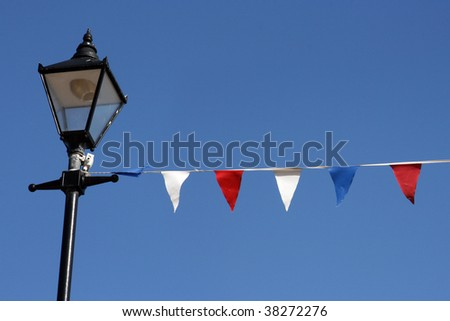 Bunting hanging from streetlight on Broadstairs seafront